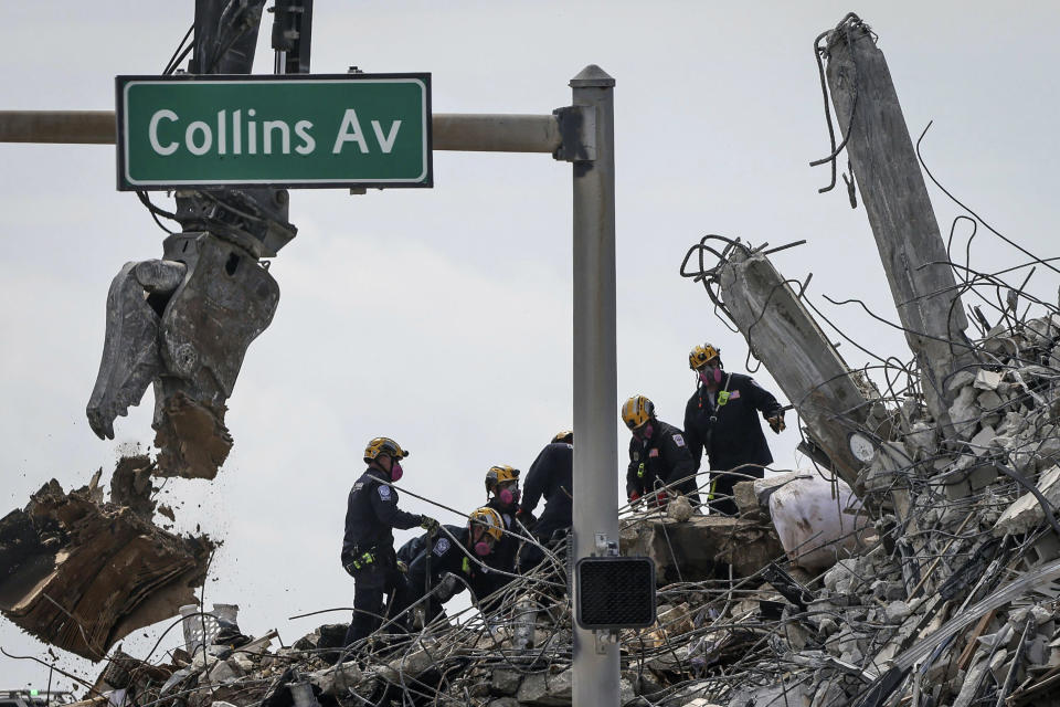 Search and rescue operations resumed as members of the Pennsylvania Search and Rescue team combed through the debris of the Champlain Tower South complex, Monday, July 5, 2021, in Surfside, Fla. (Carl Juste/Miami Herald via AP)
