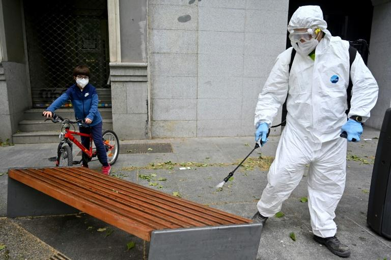 Children in Spain have been allowed out of their homes for the first time in weeks, but strict sanitary measures are in place (AFP Photo/Gabriel BOUYS)