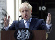FILE - In this file photo dated Wednesday, July 24, 2019, Britain's newly installed Prime Minister Boris Johnson gestures as he speaks outside 10 Downing Street in London. Britain and the European Union have struck a provisional free-trade agreement that should avert New Year's chaos for cross-border commerce and bring a measure of certainty to businesses after years of Brexit turmoil. The breakthrough on Thursday, Dec. 24, 2020 came after months of tense and often testy negotiations that whittled differences down to three key issues: fair-competition rules, mechanisms for resolving future disputes and fishing rights. (AP Photo/Frank Augstein, File)