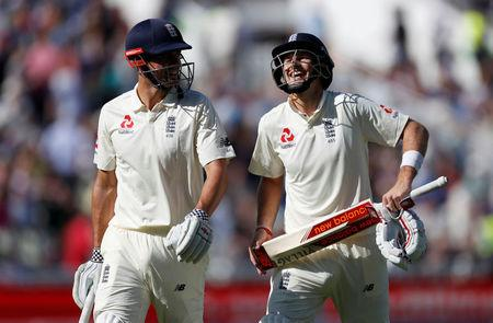 Cricket - England vs West Indies - First Test - Birmingham, Britain - August 17, 2017   England's Alastair Cook (L) and Joe Root (R) share a joke as they walk off for lunch   Action Images via Reuters/Paul Childs