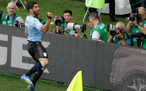 "Luis Suarez was the beneficiary of another air malfunction for Saudi Arabia as Uruguay became the second team to join hosts Russia in the last 16. An engine on the plane carrying Saudi Arabia's squad had caught fire as it came in to land at Rostov's Platov International Airport ahead of this match. Fortunately, no one on board came to any harm but that would not prove the end of the team's troubles in the air. Only Mohammed Alowais will know what he was trying to achieve as the Saudi Arabia goalkeeper came careering off his line, jumped more in hope than any expectation of catching Carlos Sanchez's corner and watched as the ball sailed over his head and into the path of Suarez to score what would prove the decisive intervention of a closely fought game. It was the Barcelona forward's 52nd goal on his 100th appearance for his country, quelling some of the criticism that greeted his performance against Egypt, and he celebrated by putting the ball up his shirt and sucking his thumb in tribute to his wife, Sofia Balbe, who is thought to be pregnant with their third child. Scorer Suarez celebrates his winner Credit: Reuters ""I am very pleased to have scored but the main thing was to win to secure progression to the next round,"" Suarez said. ""We have seen many results at this World Cup that have been rather surprising so are delighted to have got through. But we must still fine-tune a few things as we have not been at our absolute best."" Uruguay will face Russia in Samara on Monday to determine who tops Group A but if the hosts have breezed unexpectedly through the group, it has been more of a battle for the South Americans. They required a stoppage time goal to beat Egypt and, while largely comfortable here, encountered an obstinate Saudi Arabia side determined to atone for their shambolic 5-0 defeat to Russia that had sparked a national inquest. By the end, they were left to rue one glaring error which a player of Suarez's quality was never going to pass on. This was still not vintage Suarez by any means, even if his work rate could not be faulted, but then it was not vintage Uruguay either. They did enough, and could have scored one or two more, but they found the going tough for the mostpart against a Saudi Arabia team that was far more organised, compact and diligent in their work than they had been during that debacle in Moscow last week. They may be going home but they at least restored some pride. Shortly after Suarez scored, Saudi almost equalised. Martin Caceras was caught flat-footed and the lively Hatan Bahbri stole in only to direct his half volley over from Yasser Al-Shahrani's fine cross. Three of the players, including goalkeeper Abdullah Al-Muaiouf, who had started against Russia were dropped after being rather sinisterly warned they would face ""penalties"" when they returned home. So Al-Muaiouf was probably mightily relieved in that respect that he was not responsible for the mistake that gifted Suarez a straight-forward finish, although it was a shame for Al-Owais as he otherwise equipped him well and made a fine save late on to deny Edinson Cavani. It was just not Cavani's day. He stroked over a fine cross for Sanchez just after the hour mark that should have resulted in a goal but the Uruguay midfielder, who had made a lung-busting 50 yard dash into the box, got under the ball and headed over. Yet otherwise Cavani was well-shackled by a Saudi Arabia defence unrecognisable from the one that had been blown apart by Russia. Neither Cavani nor Suarez have yet to really hit their stride in this tournament. Yet Suarez ran himself into the ground and the goal will do a lot for his confidence. ""Luis fought hard and has special traits that he's showcased at all his clubs,"" Oscar Tabarez, the Uruguay coach, said. ""He always shows his character and responsibility and takes on that pressure and lives with it all the time. He is fundamental to us, he always gives hope to the team and has an enormous capacity to score goals."" 6:12PM Still, at least the match had a hero It was that nice Luis Suarez. The perfect way for @LuisSuarez9 to celebrate his 100th appearance for @Uruguay! #URUKSApic.twitter.com/gLcuS66bd3— FIFA World Cup �� (@FIFAWorldCup) June 20, 2018 I think w'll just move on from this game, you know? Cheers for following. Head over to Iran vs Spain: team news and live build-up if you like. Cheers! 6:10PM This is more like it Midfield meandering. Uruguay vs Saudi Arabia 6:10PM This gives a false impression I think. Uruguay didn't really attack much. Uruguay vs Saudi Arabia shots on goal 6:09PM Golden Boot race? 6:04PM Where does that leave the group Uruguay and Russia will play for top spot on Group A in the final group game #WorldCuphttps://t.co/ltf1X6YJx2pic.twitter.com/kJubcjhD6f— Telegraph Football (@TeleFootball) June 20, 2018 5:52PM Full time: Uruguay 1 Saudi 0 Uruguay are through to the next round, the Saudis are out. Can't say I am especially sorry to see the back of the Saudi Arabian side, very limited. Uruguay surely can do better than that, a grinding performance, set piece goal and to be honest I think we should all just move on as quickly as possible! 5:50PM 90+ mins: Uruguay 1 Saudi 0 These folks have enjoyed their afternoon Credit: Tass via Getty Just four minutes added. 5:47PM 89 mins: Uruguay 1 Saudi 0 Corner for KSA. Decent ball, it's the big sub Kanno.... gets up well... but cannot get anything on the header from that range, maybe 15 yards from goal. 5:47PM Exceptional stuff #WorldCup: @BurgerKing apologizes for ad offering free whoppers to Russian women who get pregnant by tournament stars: https://t.co/By283QyNzX— AP Sports (@AP_Sports) June 20, 2018 5:45PM 85 mins: Uruguay 1 Saudi 0 Cavani nearly slams down the lid. Bursts down the centre, getting the better of the defenders, and is about to apply the finish as the keeper comes out, but just get in a tangle. Nahitan Nandez, known as Baby Rooney, is on for Carlos Sanchez. 5:42PM 80 mins Osama Hawsawi posing with some swans #KSApic.twitter.com/pTK1wp5Jy3— Footballers with animals (@ftbllrswanimals) June 14, 2018 5:38PM 79 mins: Uruguay 1 Saudi Arabia 0 Lucas Torreira shoots from distance, Cavani sticks out a leg, could have gone anywhere, this one. And in fact nearly goes in the KSA net! Keeper wrongfooted 5:33PM 74 mins KSA are wheeling on the big man, it is is Kanno. Bahebri is the man to make way. 5:32PM 73 mins So about 20 minutes left of a disappointing game, but there's no reason why Saudi Arabia cannot pinch a point here. 5:31PM I for one am shocked Vicki Sparks became first woman to commentate on a World Cup game for UK TV when calling Portgual/Morocco earlier on BBC. This was John Terry's reaction on Instagram. Charmer. pic.twitter.com/Pd2TmXa7Jm— Kieran Cunningham (@KCsixtyseven) June 20, 2018 5:28PM Suarez: quality player Luis Suarez - the first player to score at three different editions of the #WorldCup for @Uruguay! pic.twitter.com/B2xfSuZd47— FIFA World Cup �� (@FIFAWorldCup) June 20, 2018 Martin Caceres heads a corner over, beating Al-Dawsari in the air. 5:27PM Important day History maker! Well done @vksparks who this afternoon became the FIRST EVER woman to commentate live on a #WorldCup game for British TV by taking to the mic for @BBC for #PortugalvMorocco ������������#WomeninFootballpic.twitter.com/fwHlA8ceah— Women in Football (@WomeninFootball) June 20, 2018 5:26PM 66 mins: Good ball in from the Saudis but no effort on target. Al Dawsari fouls Sanchez. Ball in from URG now, and headed over. First poor game of the World Cup? 5:24PM 64 mins The player marking Suarez keeps kicking him, and frankly why wouldn't you? Saudis break, Gimenez hauls down Al-Harbi. 5:23PM Unclear whether this is a photoshoot or just the player on his day off, but... Cristian Rodriguez patriotically riding a horse #URUpic.twitter.com/1e0R39YJ9S— Footballers with animals (@ftbllrswanimals) June 20, 2018 5:20PM 61 mins: Uruguay 1 Saudi Arabia 0 Lovely ball from Cavani, moment of proper quality. He waits, picks his moment, and puts it on the head of Sanchez... who should have done better with the free header. 5:16PM 57 mins: Uruguay 1 Saudi Arabia 0 Laxalt and Torreira are coming on for Uruguay. Vecino and Rodriguez off. 5:14PM 53 mins: Uruguay 1 Saudi Arabia 0 Mohammad Al-Breik, known to all the lads in the changing room as Ready Breik, heads back across goal but there's not a lot in the way of pressure on the ball/keeper. 5:09PM 50 mins: Uruguay 1 Saudi Arabia 0 Suarez cracks the ball at goal but it is blocked. 5:08PM 49 mins Freekick for Uruguay. Central, about 30 yards out. Saudis think they have been hard done by. And I agree: Carlos Sanchez went down cheaply after the challenge from Salma Alfaraj. 5:04PM 46 mins: Uruguay 1 Saudi Arabia 0 Decent start to the half again from the Saudis. 5:03PM Players are out for the second half Let's hope we see a bit more quality from this pair. Credit: BBC 4:52PM Ton up Suarez won his 100th cap, and opened the scoring Credit: AP 4:50PM Here's Al-Flappy Bird in the Saudi goal, bit of a howler. Saudi goalie Credit: BBC 4:48PM Half time: Uruguay 1 Saudi Arabia 0 Yes, not a classic, but Uruguay just about deserve it, and have one foot in the next round. Saudis given a decent account of themselves. 4:47PM 44 mins: Uruguay 1 Saudi Arabia 0 This has not been a great game. URG are sitting deep, KSA are... sitting deep. Uruguay vs Saudi Arabia shots on goal 4:41PM 40 mins: Uruguay 1 Saudi Arabia 0 Taiseer Aljassam is coming off. Shame. He went on a good run, stretched as he tried to keep control of the ball, and looks to have done a hamstring. Al-Moghawi on. Miss: Uruguay 1 - 0 Saudi Arabia (Salem Al Dawsari, 38 min) 4:37PM URG like to get out wide and Average touch positions (25 min) aim to cross for their front two. 4:34PM 30 mins: Uruguay 1 Saudi Arabia 0 URG needed to buck their ideas up, because they are sloppy and this Saudi side, ordinary though it may be, should be level. Simple ball comes across, Caceres loses his man, and Hatan Bahbri has spurned a simple chance from close range 4:26PM 25 mins: Uruguay 1 Saudi Arabia 0 Decent run and hit from KSA striker Hatan Bahbri, tipped over, Saudis have a corner. 4:24PM GOAL! Suarez! Uruguay 1 Saudi Arabia 0 Shocker from the keeper, shocker from the defence as well come to that. Corner comes over, keeper comes out flapping, and Suarez taps it in. But who was marking Suarez? Just not acceptable. Looks like Taisir Al Jassam was the man who let him loose. That's the Suarez we know and admire. Marks his 100th game for Uruguay with a customary poacher's goal. ����— Gary Lineker (@GaryLineker) June 20, 2018 4:22PM 22 mins: Uruguay 0 Saudi Arabia 0 That's good play from Uruguay, they are very strong down the flanks, and with their two dangerous strikers they are going to cause some problems. 4:21PM 20mins: Uruguay 0 Saudi Arabia 0 Al-Muwallad finds himself in space in the area, and with time... no. shoots well over. 4:19PM 18 mins: Uruguay 0 Saudi Arabia 0 Lofted forward for Rodriguez, he tries il spectaculari. No. 4:15PM 14 mins: Uruguay 0 Saudi Arabia 0 Ooh, danger. URG get down the flank, the tireless Suarez pops up and, gathering the ball right on the goalline, tries to lash it across. Hits the defender and goes behind. 4:13PM 11 mins: Uruguay 0 Saudi Arabia 0 Good atmosphere so far but not what you would call a classic. Martin Caceres cuts it back for Edinson Cavani, whose first-time effort is over. Miss: Uruguay 0 - 0 Saudi Arabia (Edinson Cavani, 13 min) 4:08PM 7 mins They are taking their time. Eventually it is whacked at the wall by Mohammed Alburay. Behind for a corner. Poor delivery from that as they take it short and then donk it in pointlessly. 4:07PM 6 mins Not a bad start from KSA. They're getting a few forward. They've got a freekick, central, about 30 yards out. 4:03PM 3 mins: Uruguay 0 Saudi Arabia 0 That's a handy ball forward from SA, but the formidable Godin has read it well. Suarez has unleashed one: Cristian Rodriguez knocked it down for him, and Saudi Arabia defender Ali Albulayhi did well to get in the way. Attempt Saved: Uruguay 0 - 0 Saudi Arabia (Luis Suárez, 2 min) 4:01PM 1 mins: Uruguay 0 Saudi Arabia 0 The South Americans in their pale blue, the Saudis are in white. Uruguay enjoying a few early touches at the back, allowed to stroke it about. No press from the Saudis. 4:00PM Ready to play football Credit: BBC 3:57PM Saudi one No messing. Sounds like people hailing a taxi. All over very quickly. 3:57PM Uruguay anthem is a good un There's a long and hymn like intro bit, sounds somewhat like God Save The Queen, and then a shouted call and response section. 3:55PM Rostov Arena World Cup 2018 stadium: Rostov Arena 3:54PM The players are out on the pitch It's mad hot there. 36 degrees I think they just said on the telly. Edinson Cavani celebrates with Rodrigo Bentancur after Uruguay broke the deadlock late on against Egypt Credit: GETTY IMAGES 3:46PM Great bunch of lads #URUKSA 