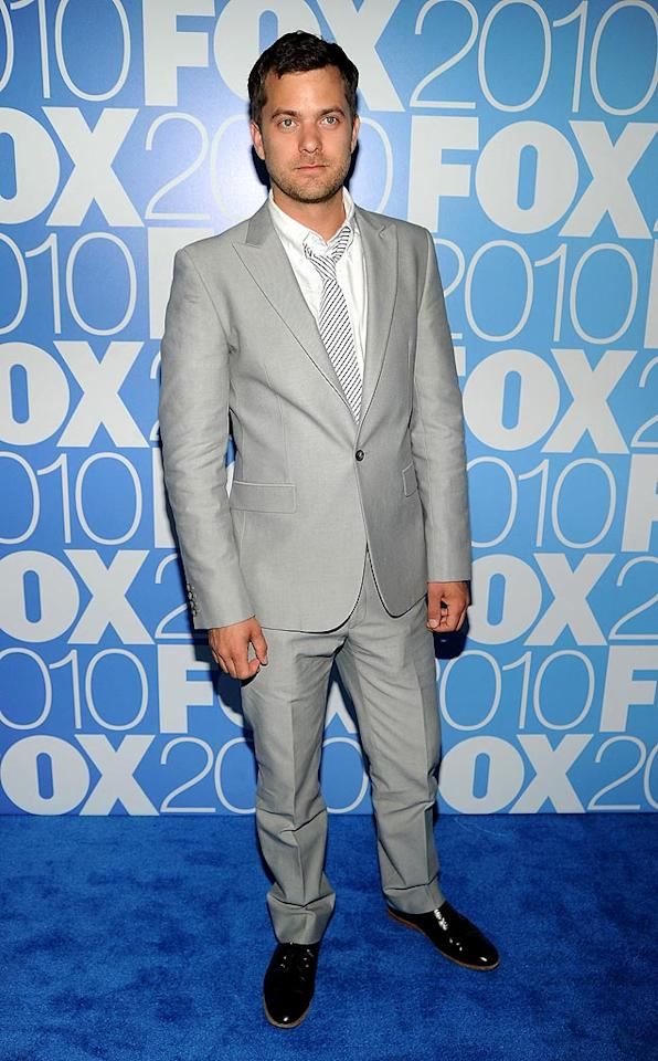 """Back in New York at the FOX upfront party, """"Fringe"""" star Joshua Jackson looked quite dapper in his sharp gray suit, striped tie, and patent leather loafers. Dimitrios Kambouris/<a href=""""http://www.wireimage.com"""" target=""""new"""">WireImage.com</a> - May 17, 2010"""