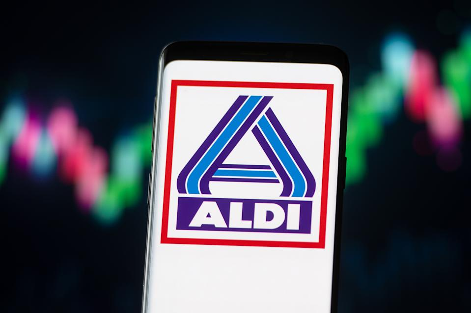 POLAND - 2020/11/04: In this photo illustration an Aldi logo seen displayed on a smartphone. (Photo Illustration by Mateusz Slodkowski/SOPA Images/LightRocket via Getty Images)