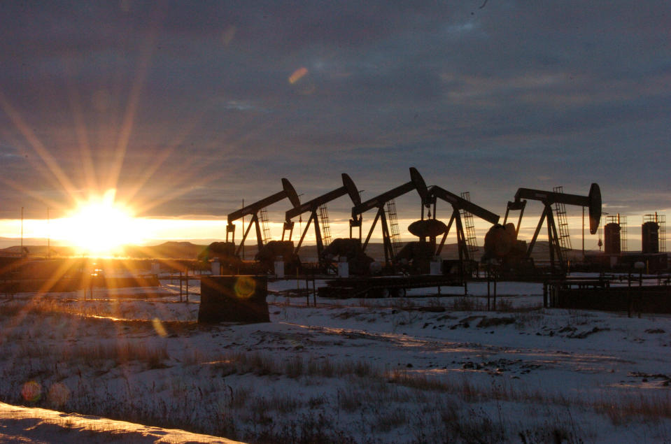 FILE - This Jan. 14, 2015 file photo shows oil pump jacks in McKenzie County in western North Dakota. President Joe Biden shut down oil and gas lease sales from the nation's vast public lands and waters in his first days in office, citing worries about climate change. Now his administration has to figure out what do with the multi-billion dollar program without crushing a significant sector of the U.S. economy, while fending off sharp criticism from congressional Republicans and the oil industry. (AP Photo/Matthew Brown, File)