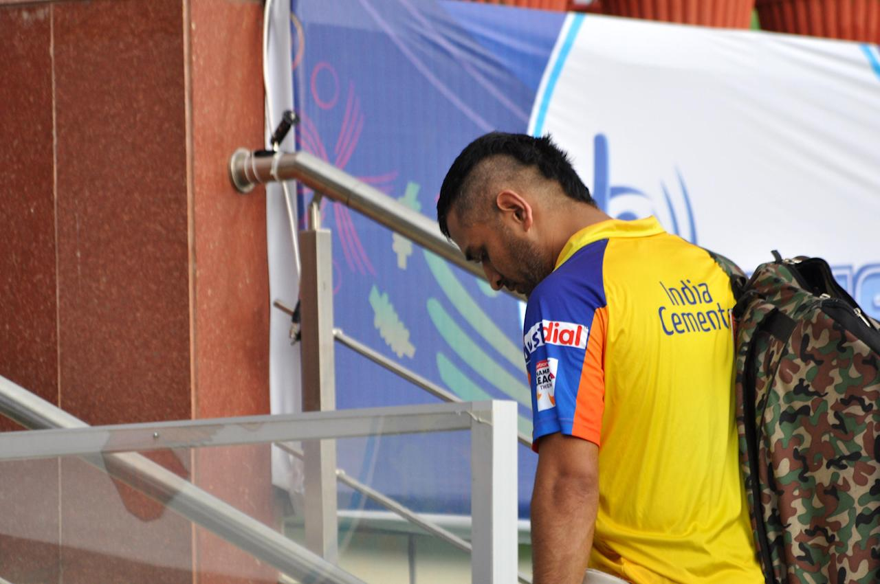 Chennai Superkings Captain Mahendra Singh Dhoni returns after practice session ahead of CLT20 match at JSCA International Cricket Stadium in Ranchi on Sept. 24, 2013. (Photo: IANS)
