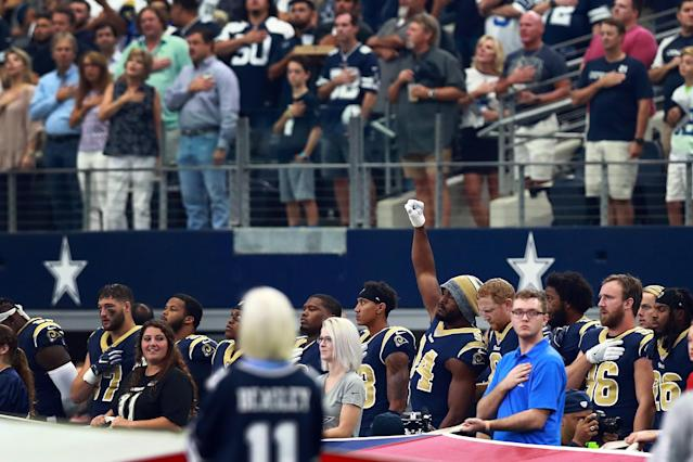 <p>Robert Quinn #94 of the Los Angeles Rams raises his fist during the National Anthem before the game against the Dallas Cowboys at AT&T Stadium on October 1, 2017 in Arlington, Texas. (Photo by Tom Pennington/Getty Images) </p>