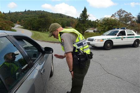 Park Ranger Joseph Darling directs visitors away from the entrance to the Pisgah Inn on the Blue Ridge Parkway southwest of Asheville