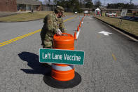Georgia Air National Guardsman Sgt. Owen Bock works to set up a mass vaccination site at the Macon State Farmers Market on Friday, Feb. 19, 2021, in Atlanta. Officials say starting Monday they plan to vaccinate 1,100 a day at the site. (AP Photo/John Bazemore)