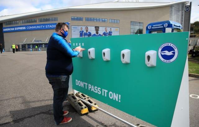 Fans sanitise their hands before the Brighton v Chelsea pre-season friendly on August 29, 2020