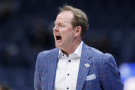 FILE - In this March 11, 2020, file photo, Mississippi head coach Kermit Davis yells to his players in the first half of an NCAA college basketball game against Georgia in the Southeastern Conference Tournament in Nashville, Tenn. Davis has tested positive for COVID-19 and could be sidelined when the season starts. Ole Miss announced the positive test on Tuesday, Nov. 17, 2020, saying if a follow-up test is also positive Davis will isolate at home and miss the Rebels first two games. (AP Photo/Mark Humphrey, File)