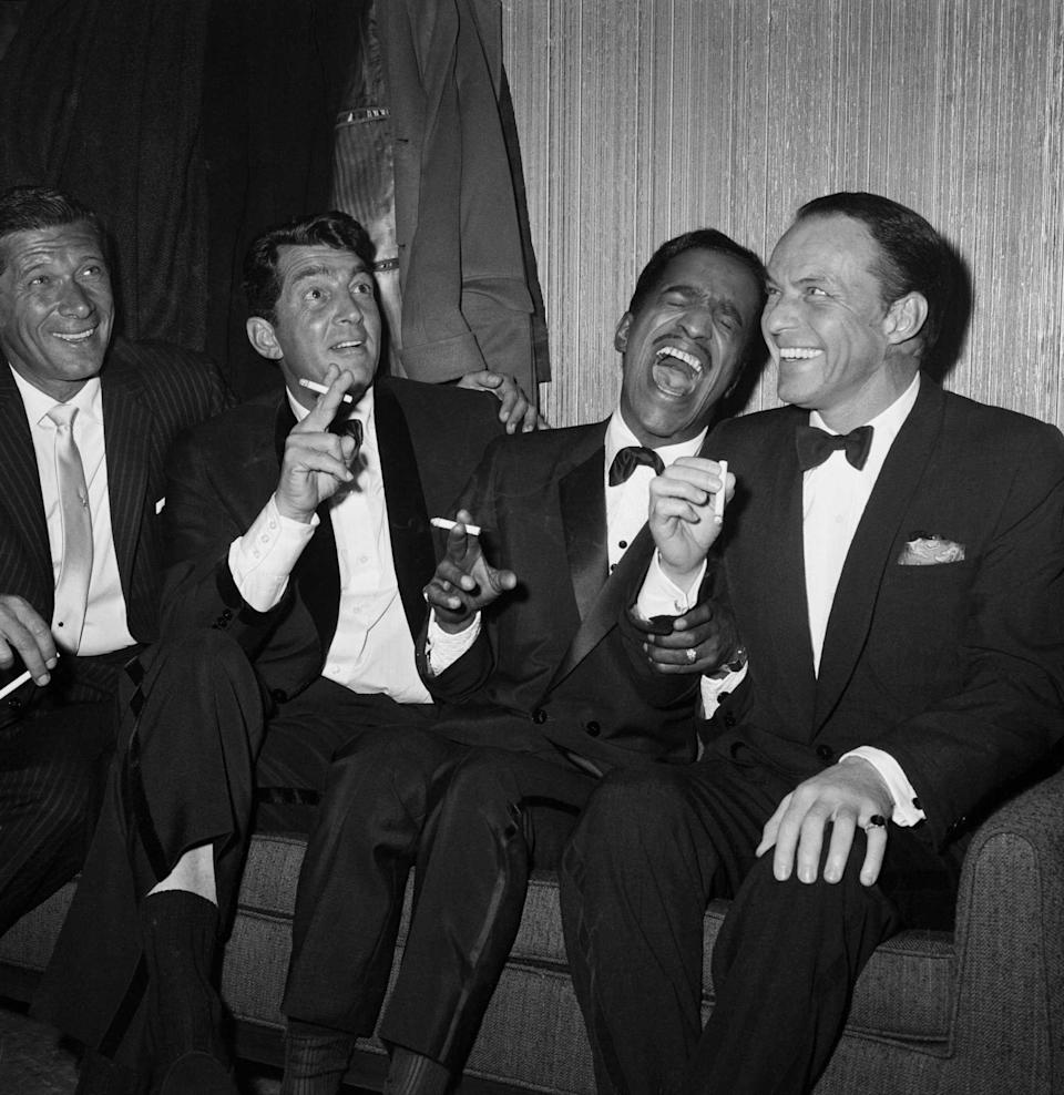 """<p>There hasn't been an era quite like the height of the Rat Pack from the <a href=""""https://www.redbookmag.com/life/g35337564/things-60s-kids-did-that-would-horrify-us-now/"""" rel=""""nofollow noopener"""" target=""""_blank"""" data-ylk=""""slk:1960s"""" class=""""link rapid-noclick-resp"""">1960s</a>. This unofficial group comprised of Frank Sinatra, Dean Martin, Sammy Davis Jr., Joey Bishop and Peter Lawford had cameras flashing wherever they went. Not only did they sing together, but they also acted in a range of <a href=""""https://www.redbookmag.com/about/g34643628/best-movie-songs/"""" rel=""""nofollow noopener"""" target=""""_blank"""" data-ylk=""""slk:films"""" class=""""link rapid-noclick-resp"""">films</a> including <em>Ocean's Eleven</em> and <em>Robin and the 7 Hoods </em>and made talk show appearances together. Whenever the group of talented entertainers got together, it was always pure and genuine excitement. Please enjoy these iconic photos of the Rat Pack. </p>"""
