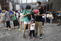 Residents visit a weekend open air market in Beijing on Saturday, Aug. 8, 2020. As the coronavirus outbreak comes under control in the Chinese capital, normal life is slowing returning albeit with the requisite masks. (AP Photo/Ng Han Guan)
