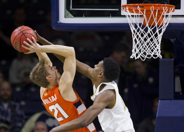 Notre Dame's Juwan Durham, right, blocks a shot by Syracuse's Marek Dolezaj(21) during the first half of an NCAA college basketball game Wednesday, Jan. 22, 2020, in South Bend, Ind. (AP Photo/Robert Franklin)