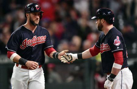 Cleveland Indians catcher Yan Gomes (7) celebrates with center fielder Jason Kipnis (22) after scoring during the fifth inning against the Chicago White Sox at Progressive Field, Cleveland, OH, USA, September 30, 2017. Mandatory Credit: Ken Blaze-USA TODAY Sports