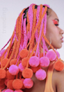 Who says your box braids need to match your actual hair? Or be a realistic hair color for that matter? Be bold and step out of your comfort zone with these neon pink and orange braids. The balls on the end are the perfect finishing touch.
