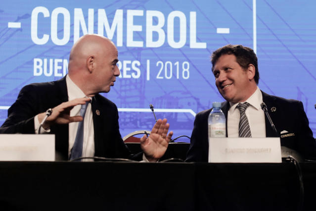FILE - In this Thursday, April 12, 2018 file photo, FIFA President Gianni Infantino, left, talks with Alejandro Dominguez, right, president of the South American Football Confederation, CONMEBOL, during their annual conference in Buenos Aires, Argentina. FIFA hosted talks Monday April 30, 2018, with footballs six continental governing bodies about a $25 billion offer to run two international competitions, seeking agreement before the World Cup kicks off in June. (AP Photo/Martin Ruggiero, File)