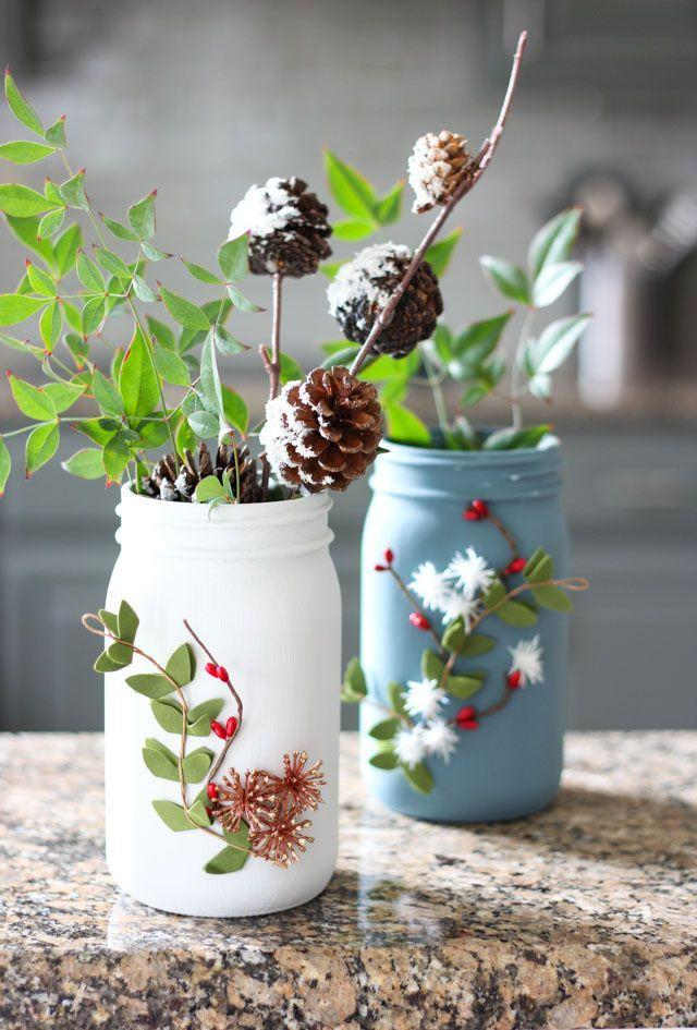 """<p>Painted with chalk paint and decorated with faux greenery, these Christmas vases are just as lovely as the foliage they contain.</p><p><strong>Get the tutorial at <a href=""""https://designimprovised.com/2017/12/secret-santa-exchange-ball-brand-jar-winter-vases.html"""" rel=""""nofollow noopener"""" target=""""_blank"""" data-ylk=""""slk:Design Improvised"""" class=""""link rapid-noclick-resp"""">Design Improvised</a>.</strong></p><p><a class=""""link rapid-noclick-resp"""" href=""""https://www.amazon.com/ARTY-KRAFTS-Painting-Polyurethane-Disposable/dp/B08D7GR6DC/ref=sr_1_2_sspa?tag=syn-yahoo-20&ascsubtag=%5Bartid%7C10050.g.2132%5Bsrc%7Cyahoo-us"""" rel=""""nofollow noopener"""" target=""""_blank"""" data-ylk=""""slk:SHOP FOAM BRUSHES"""">SHOP FOAM BRUSHES</a><br></p>"""