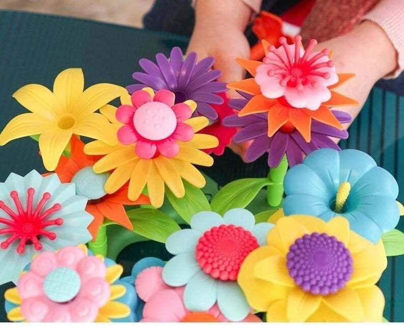 """This 112-piece set will help give any aspiring botanist or florist a start — with no dirt tracked into the house.<br /><br />BTW: Axel Adventures is an Etsy shop and family-run online toy store established in 2020 and based in Nevada.<br /><br /><strong>Promising review:</strong>""""The flowers are a big hit, and arrived on time!"""" —<a href=""""https://go.skimresources.com?id=38395X987171&xs=1&xcust=HPToddlerToys607dd44ee4b0df3610beec33&url=https%3A%2F%2Fwww.etsy.com%2Fshop%2FSidewaysTees"""" target=""""_blank"""" rel=""""noopener noreferrer"""">Dean</a><br /><strong><br />Get it from<a href=""""https://go.skimresources.com?id=38395X987171&xs=1&xcust=HPToddlerToys607dd44ee4b0df3610beec33&url=https%3A%2F%2Fwww.etsy.com%2Fshop%2FAxelAdventures"""" target=""""_blank"""" rel=""""noopener noreferrer"""">Axel Adventures</a>on Etsy for<a href=""""https://go.skimresources.com?id=38395X987171&xs=1&xcust=HPToddlerToys607dd44ee4b0df3610beec33&url=https%3A%2F%2Fwww.etsy.com%2Flisting%2F871532016%2Fcolorful-build-a-flower-toy-building"""" target=""""_blank"""" rel=""""noopener noreferrer"""">$33.37</a>.</strong>"""