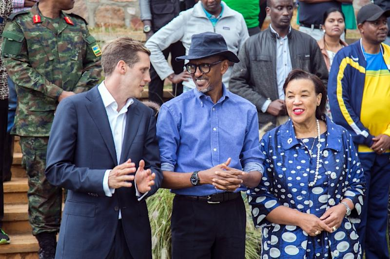 Rwandan President Paul Kagame(C), Project Director of the Rwanda Cricket Stadium Foundation Alb Shale (L) and Secretary General of the Commonwealth Patricia Scotland applaud and react during the official inauguration of the Gahanga Cricket Oval on October 28, 2017, in Kigali (AFP Photo/Cyril NDEGEYA)