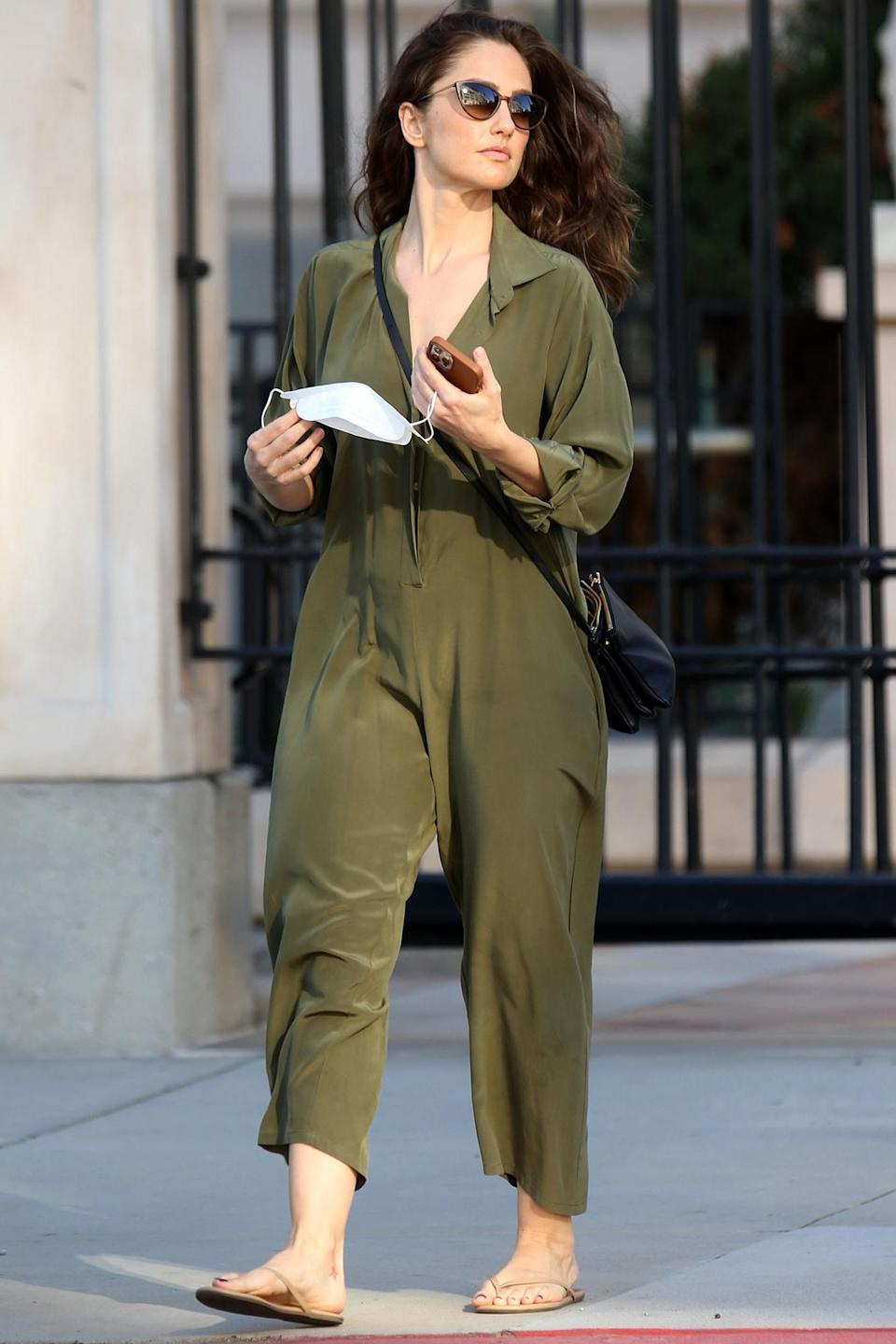 <p>Minka Kelly was out and about in Beverly Hills, California, wearing an olive jumpsuit.</p>