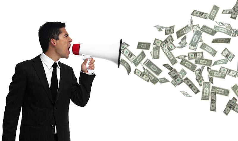 A person yelling into a bullhorn with money coming out the other side.