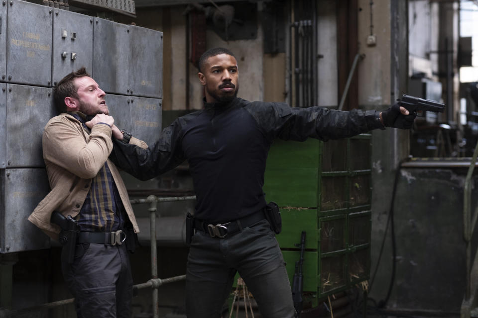 "This image released by Amazon shows Jamie Bell , left, and Michael B. Jordan in a scene from ""Tom Clancy's Without Remorse."" (Nadja Klier/Amazon via AP)"
