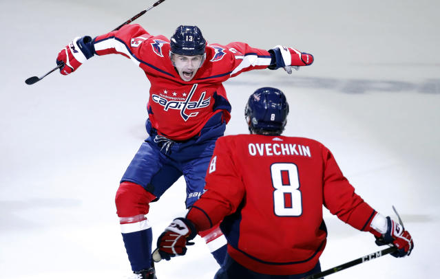 FILE - In this May 5, 2018, file photo, Washington Capitals left wing Jakub Vrana (13), from the Czech Republic, jumps into the arms of left wing Alex Ovechkin (8), from Russia, after scoring the go-ahead goal during the third period of Game 5 in the second round of the NHL Stanley Cup hockey playoffs against the Pittsburgh Penguins, in Washington. The Capitals have never used more rookies during a single postseason than the half-dozen who helped Alex Ovechkin and Co. reach the Eastern Conference final against the Tampa Bay Lightning. Rookie Vrana delivered an assist on tying the score before putting the go-ahead goal in the net.(AP Photo/Alex Brandon, File)