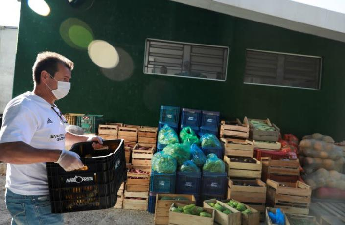 Former Brazil's head soccer coach Dunga helps with food distribution to poor people, amid the coronavirus disease (COVID-19) outbreak, in Porto Alegre