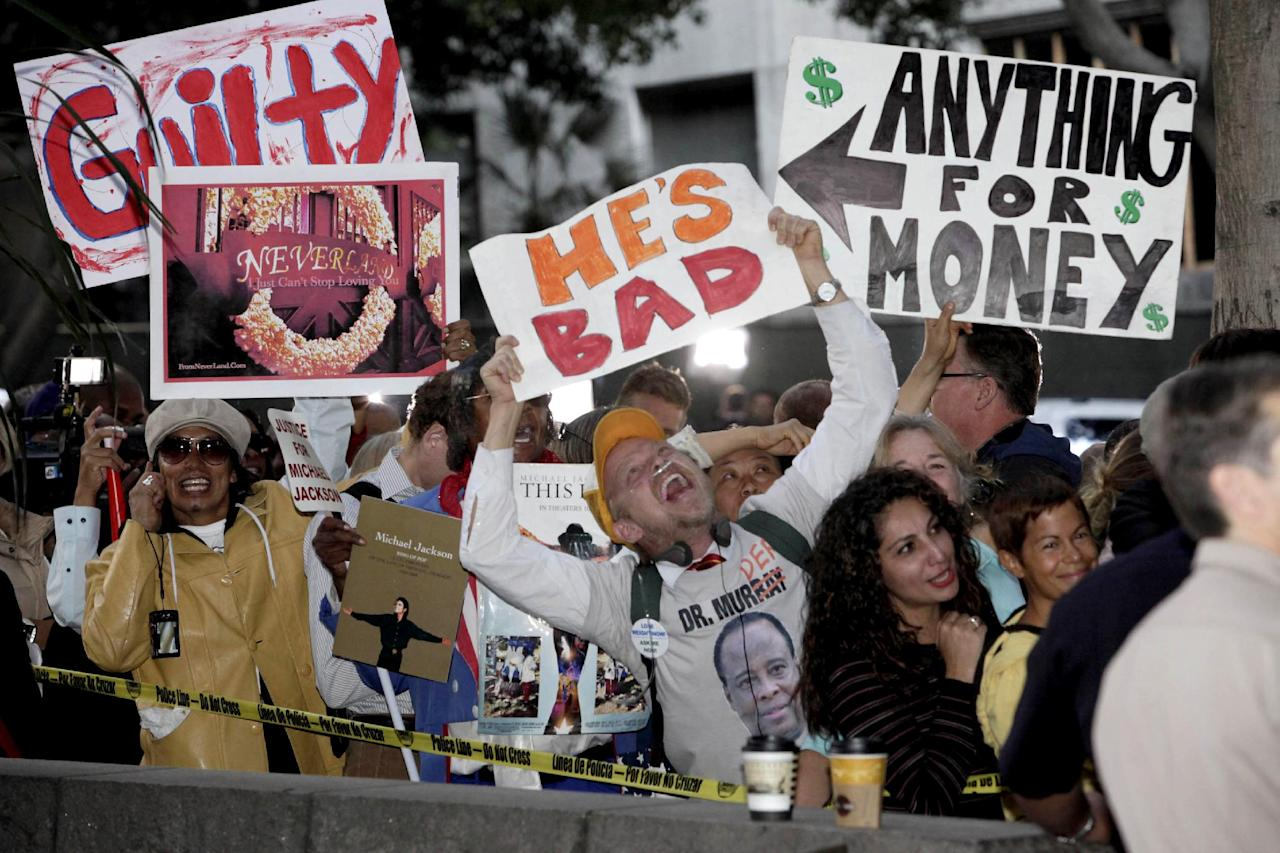 Demonstrators stand outside the Criminal Justice Center in downtown Los Angeles, Monday, Nov. 7, 2011 after it was announced that jurors had reached a verdict in the involuntary manslaughter trial of Dr. Conrad Murray, Michael Jackson's physician when the pop star died in 2009. (AP Photo/Nick Ut)