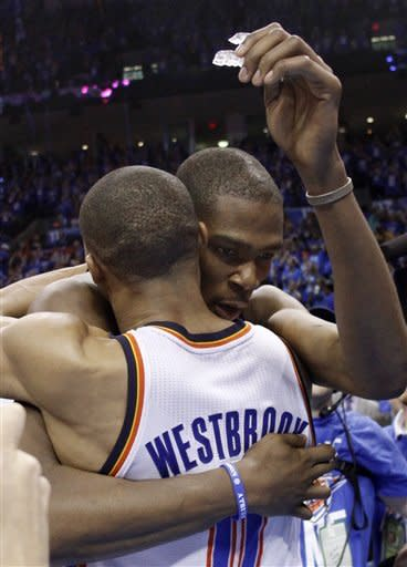 Oklahoma City Thunder forward Kevin Durant, right, and guard Russell Westbrook, left, embrace after defeating the Dallas Mavericks in Game 1in the first round of the NBA basketball playoffs, in Oklahoma City, Saturday, April 28, 2012. (AP Photo/Sue Ogrocki)