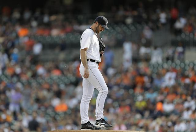 Detroit Tigers pitcher Justin Verlander readies himself before pitching against the Kansas City Royals in the first inning of a baseball game in Detroit, Monday, June 16, 2014. (AP Photo/Paul Sancya)