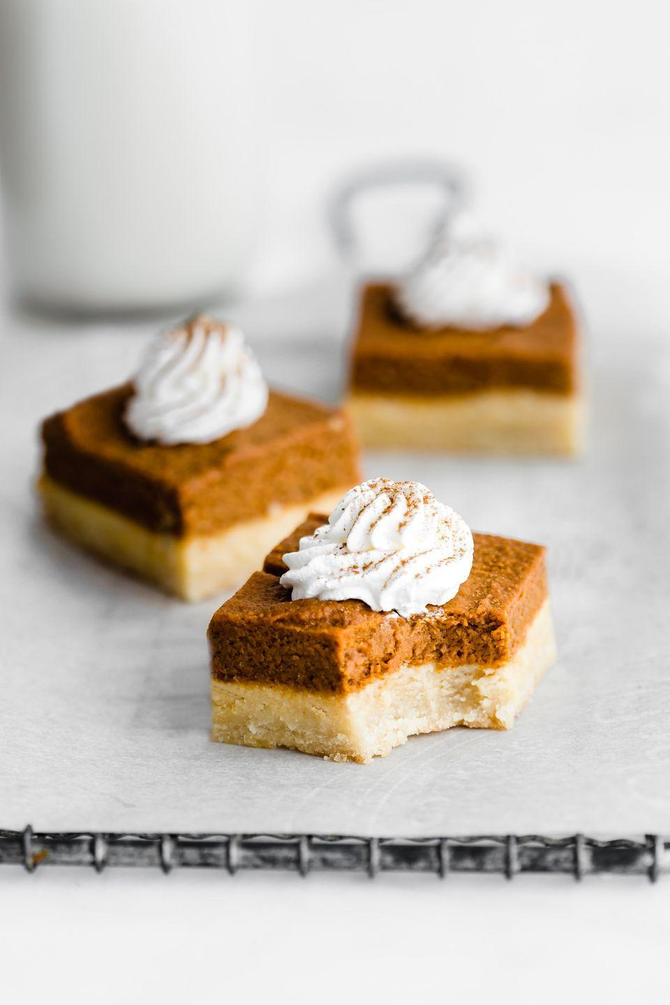 "<p>If your dinner guests prefer to fill their plate with an assortment of sweet treats, opt for these bite-size bars rather than a whole pumpkin pie. Just don't skimp out on the homemade whipped cream!</p><p><a href=""https://choosingchia.com/pumpkin-pie-bars-with-almond-cookie-crust-vegan-paleo/"" rel=""nofollow noopener"" target=""_blank"" data-ylk=""slk:Get the recipe at Choosing Chia »"" class=""link rapid-noclick-resp"">Get the recipe at Choosing Chia »</a></p>"
