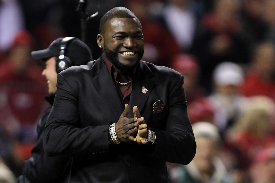 ST LOUIS, MO - OCTOBER 20: David Ortiz of the Boston Red Sox smiles on the field after receiving the 2011 Roberto Clemente Award presented by Chevrolet before Game Two of the MLB World Series between the Texas Rangers and the St. Louis Cardinals at Busch Stadium on October 20, 2011 in St Louis, Missouri. (Photo by Ezra Shaw/Getty Images)