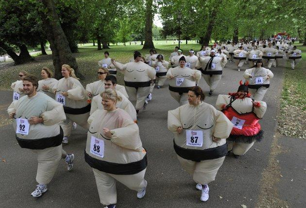 Runners dressed in inflatable Sumo costumes take part in a charity 5km (3 miles) run at Battersea Park in London June 19, 2010. Organisers claimed a new world record for a mass Sumo suit gathering at the annual event. REUTERS/Toby Melville
