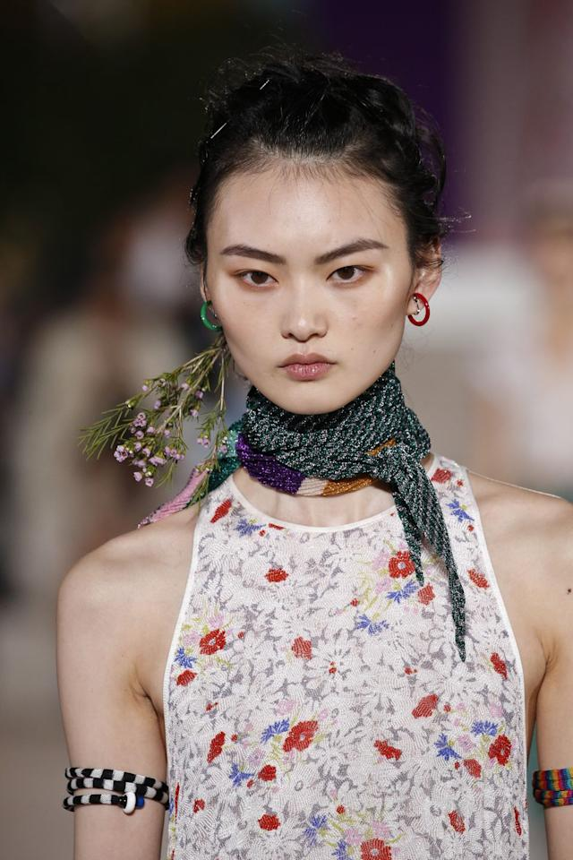 <p>As long as there continue to be new and different ways to wear flowers in our hair, we'll keep sharing them. At Missoni's Spring '20 show, for instance, hair was wrapped and pinned around the stem to create a floral French twist that would be stunning for a summer wedding.</p>