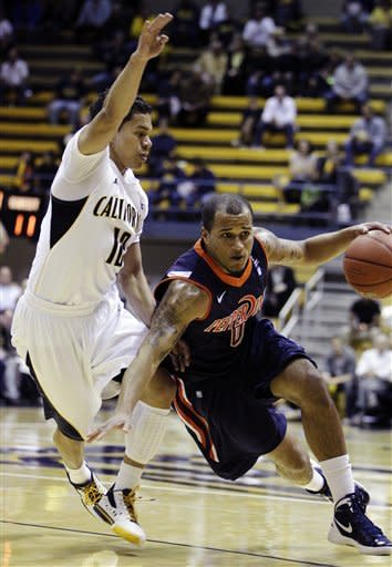Pepperdine's Lorne Jackson, right, drives the ball against California's Brandon Smith (12) during the first half of an NCAA college basketball game, Tuesday, Nov. 13, 2012, in Berkeley, Calif. (AP Photo/Ben Margot)