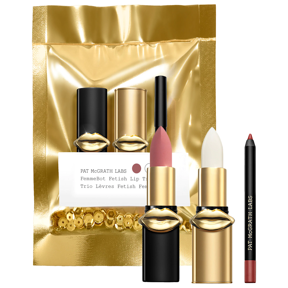 """This trio of mini lip products may just be one of the best beauty gift sets out there, even if you're not on a budget. For one, it comes in a gold package filled with gold glitter sequins (what is more holiday appropriate than that?), and secondly, it contains everything you need for the perfect neutral lip. $25, Sephora. <a href=""""https://www.sephora.com/product/pat-mcgrath-labs-mini-fembot-fetish-balm-trios-P463102"""" rel=""""nofollow noopener"""" target=""""_blank"""" data-ylk=""""slk:Get it now!"""" class=""""link rapid-noclick-resp"""">Get it now!</a>"""