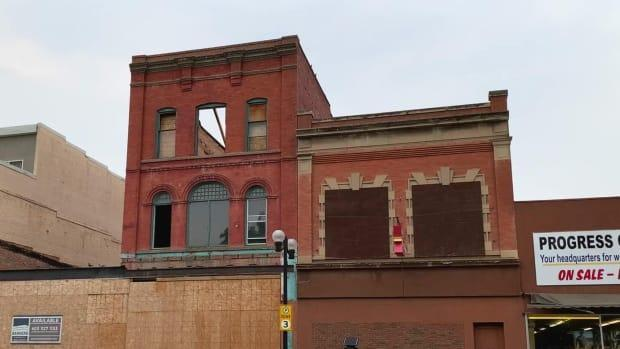 The Bentley Block, located on a prominent street in downtown Lethbridge, became the city's first three-storey building in the early 1900s, selling groceries, clothing, footwear and dry goods, according to the Alberta Register of Historic Places. But in recent years, the building has fallen into neglect. (Joel Dryden/CBC - image credit)