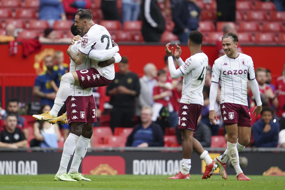 Aston Villa players celebrate at the end of the English Premier League soccer match between Manchester United and Aston Villa at the Old Trafford stadium in Manchester, England, Saturday, Sept 25, 2021. (AP Photo/Jon Super)