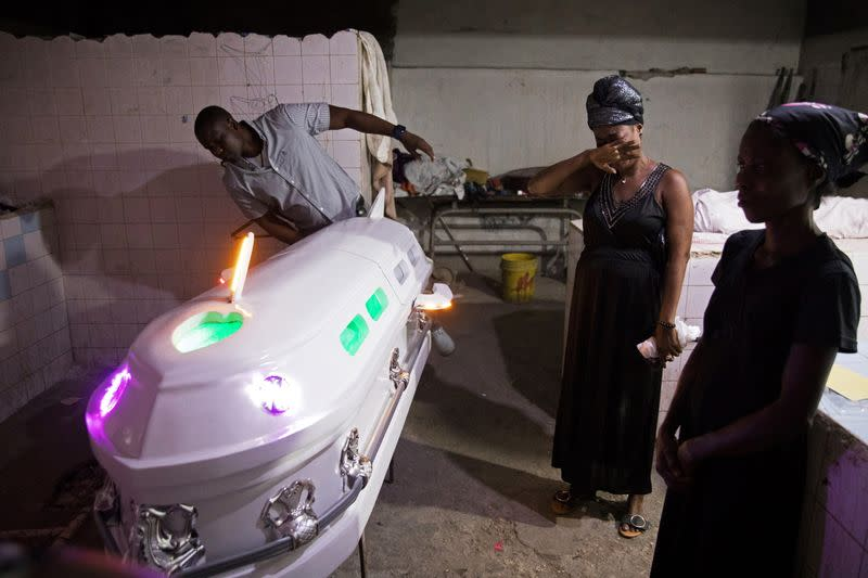 The Wider Image: In Haiti, festive wakes and Voodoo undertakers help mourners say their last goodbyes