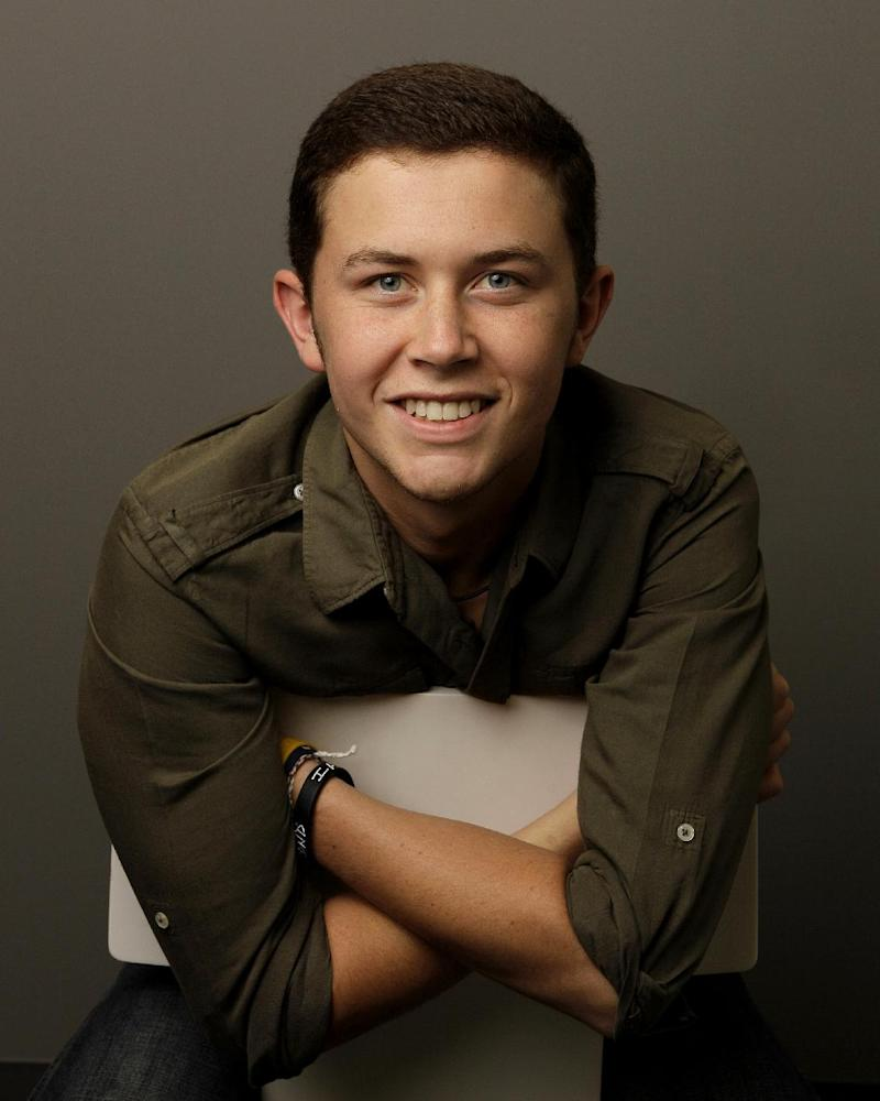"This Sept. 29, 2011 photo shows 2011 American Idol winner Scotty McCreery in Nashville, Tenn. McCreery's debut album, ""Clear As Day,""  was released Tuesday, Oct. 4. (AP Photo/Mark Humphrey)"