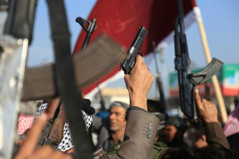 Armed members of Karbala clans take to the streets to declare their support for the Iraqi armed forces
