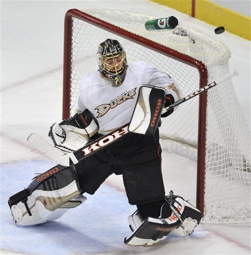 Anaheim Ducks goalie Jonas Hiller, of the Czech Republic, makes a save against the Chicago Blackhawks during the second period of an NHL hockey game in Chicago, Friday, March, 29, 2013. Anaheim won 2-1. (AP Photo/Paul Beaty)