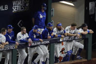 Members of the Los Angeles Dodgers watch during the ninth inning in Game 2 of the baseball World Series against the Tampa Bay Rays Wednesday, Oct. 21, 2020, in Arlington, Texas. (AP Photo/Sue Ogrocki)