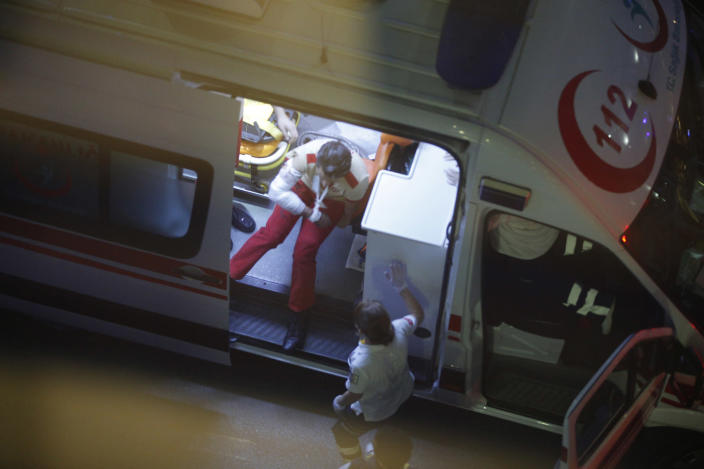 <p>An injured person sits in an ambulance outside Istanbul's Ataturk airport, Tuesday, June 28, 2016. Two explosions have rocked Istanbul's Ataturk airport, killing several people and wounding scores of others, Turkey's justice minister and another official said Tuesday. A Turkish official says two attackers have blown themselves up at the airport after police fired at them. The official said the attackers detonated the explosives at the entrance of the international terminal before entering the x-ray security check. (AP Photo/Emrah Gurel) </p>
