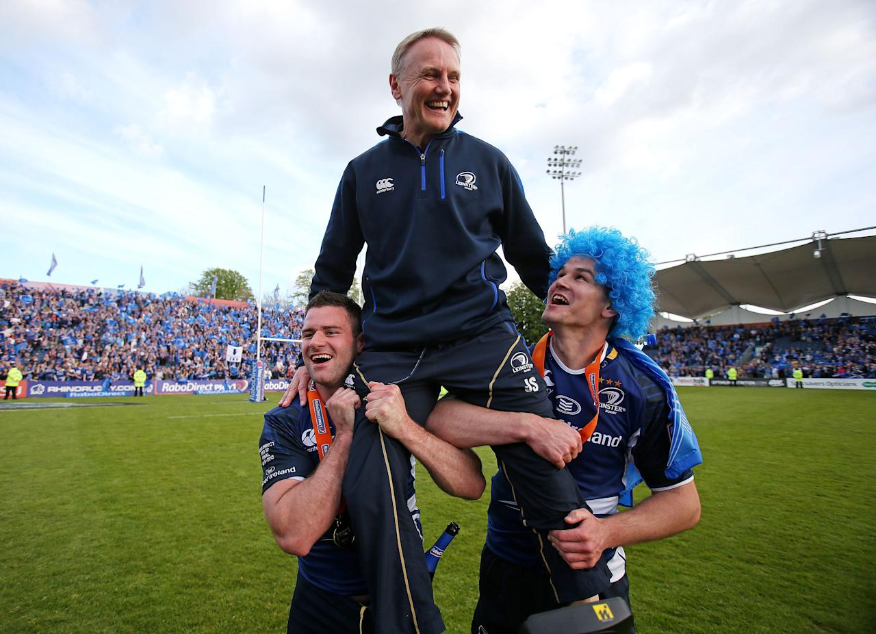 Leinster's Jonny Sexton and Fergus McFadden carry their coach Joe Schmidt as they celebrate victory during the RaboDirect PRO12 Final at the RDS, Dublin, Ireland.