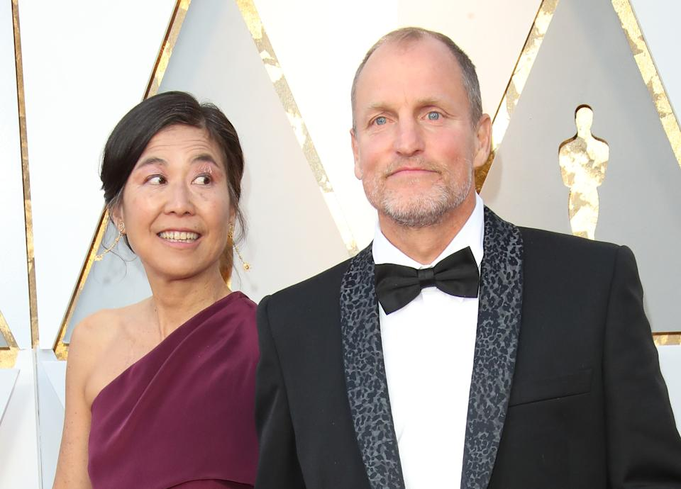 HOLLYWOOD, CA - MARCH 04: Laura Louie (L) and Woody Harrelson attend the 90th Annual Academy Awards at Hollywood & Highland Center on March 4, 2018 in Hollywood, California. (Photo by Dan MacMedan/WireImage)