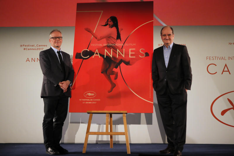 General Delegate of the Cannes Film Festival Thierry Fremaux, left and Cannes Film Festival President Pierre Lescure pose during a press conference for the presentation of the 70th Cannes film festival, in Paris, Thursday, April 13, 2017. A Civil War film by Sofia Coppola, a Ukrainian road movie and a film about AIDS activism are among 18 films competing for the top prizes at this year's Cannes Film Festival, which organizers hope can help counter nationalist sentiment. (AP Photo/Francois Mori)