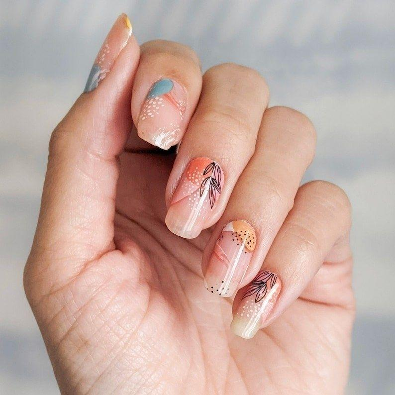 "If you want a fancy at-home mani, these pretty wraps will give you salon-quality nails in minutes. Just peel, stick, file and you'll be good to go!<br /><br /><a href=""https://go.skimresources.com?id=38395X987171&xs=1&url=https%3A%2F%2Fwww.etsy.com%2Fshop%2FPrettyFabNails%3Fref%3Dsimple-shop-header-name%26listing_id%3D914542200&xcust=HPMagicBeauty6091b722e4b04620270cedda"" target=""_blank"" rel=""noopener noreferrer"">Pretty Fab Nails</a> is a small Etsy shop that specializes in darling nail wrap designs, stickers and nail tools. <br /><br /><strong>Promising review:</strong> ""I wanted to wait to review these nail wraps as they just kept going! I bought these thinking I would be happy if they lasted the weekend... <strong>I finally removed them last night after 26 days!</strong> I followed the application instructions (swipe nail with nail polish remover beforehand), and finished with a top coat, making sure to cap the tip of the nail too. When wearing these nails, I bathed, I swam, and they still lasted! One set will be enough for two applications for short nails. I would definitely purchase these again!"" — <a href=""https://go.skimresources.com?id=38395X987171&xs=1&url=https%3A%2F%2Fwww.etsy.com%2Fshop%2FPrettyFabNails%3Fref%3Dsimple-shop-header-name%26listing_id%3D914542200&xcust=HPMagicBeauty6091b722e4b04620270cedda"" target=""_blank"" rel=""noopener noreferrer"">Charlotte Wilkinson</a><br /><br /><strong>Get a set from <a href=""https://go.skimresources.com?id=38395X987171&xs=1&url=https%3A%2F%2Fwww.etsy.com%2Fshop%2FPrettyFabNails%3Fref%3Dsimple-shop-header-name%26listing_id%3D914542200&xcust=HPMagicBeauty6091b722e4b04620270cedda"" target=""_blank"" rel=""nofollow noopener noreferrer"" data-skimlinks-tracking=""5906615"" data-vars-affiliate=""AWIN"" data-vars-campaign=""BeautyProductsCouldBeMagicSuazo3-25-21-5906615-"" data-vars-href=""https://www.awin1.com/cread.php?awinmid=6220&awinaffid=304459&clickref=BeautyProductsCouldBeMagicSuazo3-25-21-5906615-&ued=https%3A%2F%2Fwww.etsy.com%2Fshop%2FPrettyFabNails"" data-vars-keywords=""cleaning"" data-vars-link-id=""16596488"" data-vars-price="""" data-vars-product-id=""21066870"" data-vars-product-img="""" data-vars-product-title="""" data-vars-retailers=""etsy"" data-ml-dynamic=""true"" data-ml-dynamic-type=""sl"" data-orig-url=""https://www.awin1.com/cread.php?awinmid=6220&awinaffid=304459&clickref=BeautyProductsCouldBeMagicSuazo3-25-21-5906615-&ued=https%3A%2F%2Fwww.etsy.com%2Fshop%2FPrettyFabNails"" data-ml-id=""34"">Pretty Fab Nails</a> on Etsy for <a href=""https://go.skimresources.com?id=38395X987171&xs=1&url=https%3A%2F%2Fwww.etsy.com%2Flisting%2F914542200%2Fpastel-floral-negative-space-nail-polish&xcust=HPMagicBeauty6091b722e4b04620270cedda"" target=""_blank"" rel=""nofollow noopener noreferrer"" data-skimlinks-tracking=""5906615"" data-vars-affiliate=""AWIN"" data-vars-campaign=""BeautyProductsCouldBeMagicSuazo3-25-21-5906615-"" data-vars-href=""https://www.awin1.com/cread.php?awinmid=6220&awinaffid=304459&clickref=BeautyProductsCouldBeMagicSuazo3-25-21-5906615-&ued=https%3A%2F%2Fwww.etsy.com%2Flisting%2F914542200%2Fpastel-floral-negative-space-nail-polish"" data-vars-keywords=""cleaning"" data-vars-link-id=""16596487"" data-vars-price="""" data-vars-product-id=""21066851"" data-vars-product-img=""https://f.i.etsystatic.com/24604147/r/il/34ad00/2793609679/il_1588xN.2793609679_odcc.jpg"" data-vars-product-title=""Pastel Floral Negative Space Nail Polish Wraps; Transparent Spring Floral Nail Strips"" data-vars-retailers=""etsy"" data-ml-dynamic=""true"" data-ml-dynamic-type=""sl"" data-orig-url=""https://www.awin1.com/cread.php?awinmid=6220&awinaffid=304459&clickref=BeautyProductsCouldBeMagicSuazo3-25-21-5906615-&ued=https%3A%2F%2Fwww.etsy.com%2Flisting%2F914542200%2Fpastel-floral-negative-space-nail-polish"" data-ml-id=""35"">$5.99</a>.</strong>"