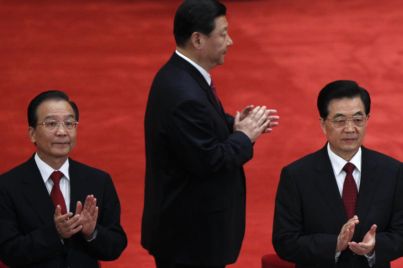 In this photo taken May 4, 2012, Chinese President Hu Jintao, right, Premier Wen Jiabao, left, and Vice President Xi Jinping clap as they arrive for a conference to celebrate the 90th anniversary of the founding of the Chinese Communist Youth League at the Great Hall of the People in Beijing. Five years after he was picked as successor, Xi remains on track to take over from President Hu in the Communist Party's fall congress, where its leading members will install a new generation of leaders. (AP Photo/Alexander F. Yuan)
